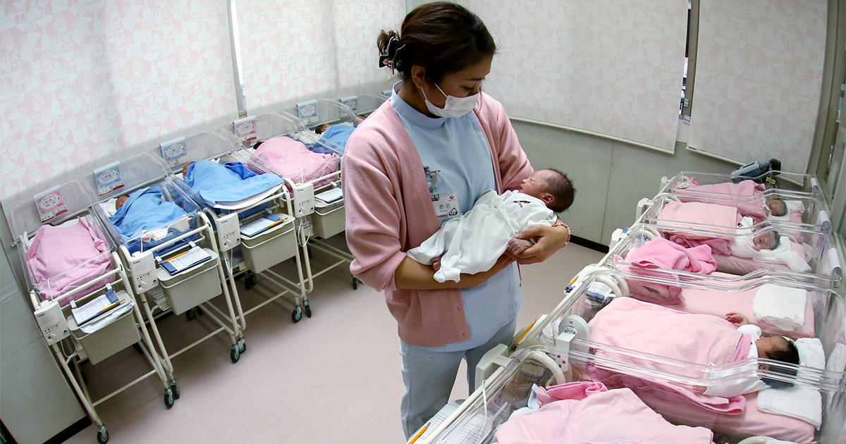 nurse tends babies in Japanese nursery